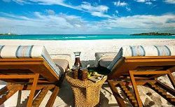 Bahamas - Lounge chairs facing the ocean, generic beach scene